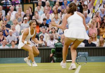 Women's Doubles - Italy's Sara Errani and Roberta Vinci celebrate winning the final