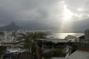 The sun shines through a cloud over the Lagoa Rodrigo de Freitas in Rio de Janeiro