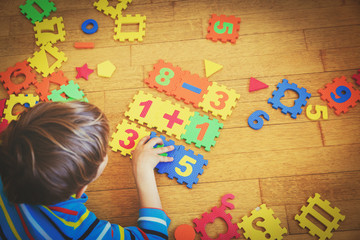 little boy playing with puzzle, education concept