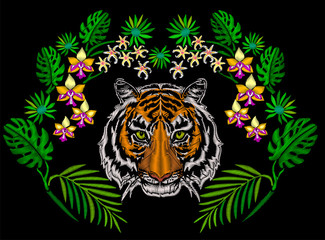 Tiger in the jungle embroidery for clothing decoration symmetrical ornament with exotic flower and palm leaves.