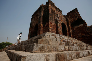 A Muslim man arrives to offer the Friday prayers during the holy month of Ramadan at the ruins of the Feroz Shah Kotla mosque in New Delhi
