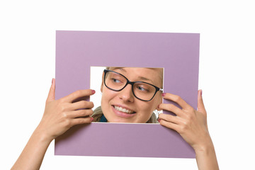 Beautiful girl in a picture frame on a white background.