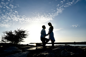 Silhouette couple on the beach with sunset