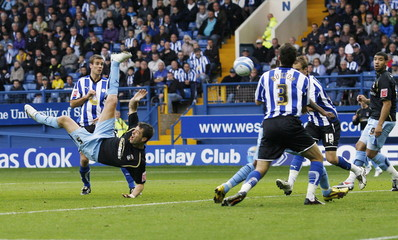 Coventry City's Elliot Ward tries an overhead kick