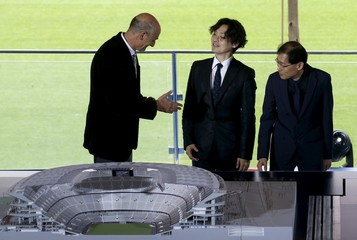 FC Barcelona member of the board Moix, architect Katsuka, Nikken Sekkei's President Kamei speak next to a model of the project to reform the Camp Nou stadium in Barcelona