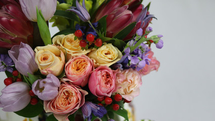 Bloom mix flowers and colorful roses in bouquet