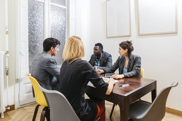 Business people discussing in office meeting