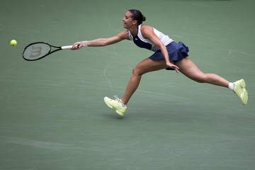 Flavia Pennetta of Italy lunges for a ball hit by compatriot Roberta Vinci during their women's singles final match at the U.S. Open tennis tournament in New York