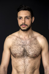 portrait of handsome shirtless hairy man