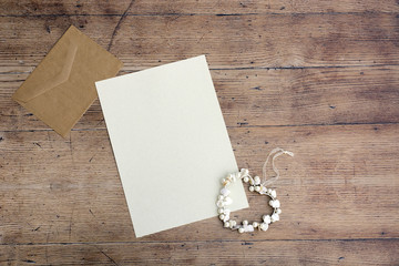 Blank white greeting card with brown envelop