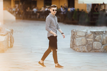 Fashionable man walk outdoors with white background street