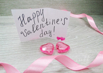 valentine's day composition of greeting card and hearts