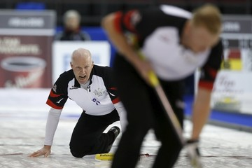 Team Ontario skip Howard shouts to teammates at the Brier curling championships in Ottawa