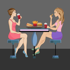 Two women eating fast food on dark background