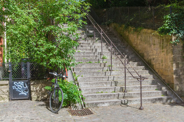 Paris, typical staircase with a parked bike on the rail