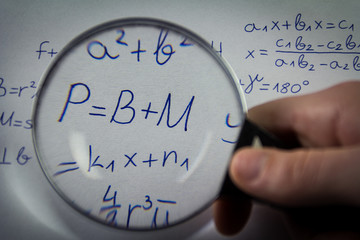 Mathematical formulas viewed through a magnifying glass