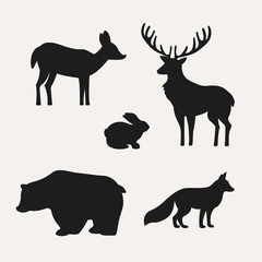 Animal silhouettes on white background. Silhouettes of deer, hare, bear and fox. Vector illustration.