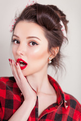 beautiful young woman on white background in old fashion clothes representing pinup and retro style
