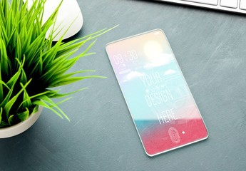 Futuristic Mobile Device on a Gray Desk Mockup