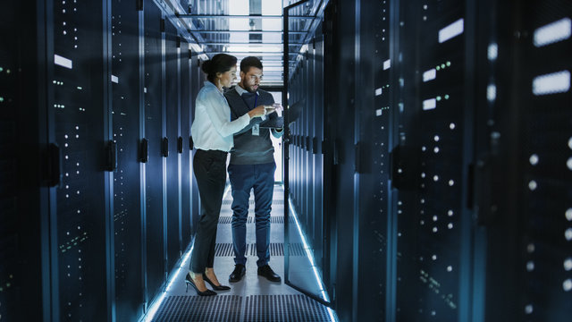 Woman and man working in server room