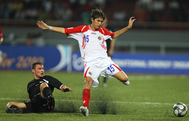 New Zealand's Tane Gent (left)  in action with Costa Rica's Joseph Mora