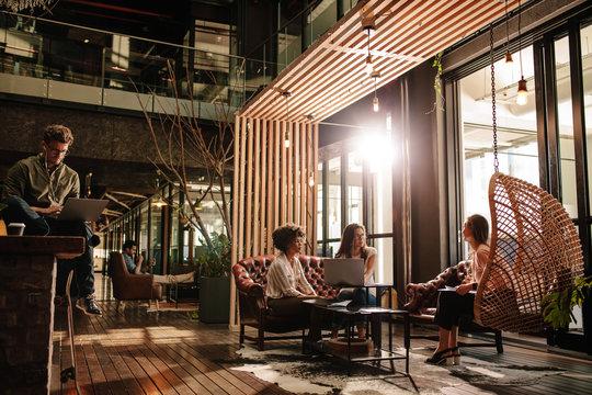 Creative business people taking a break in social room
