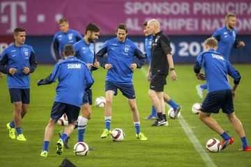 Finland's national soccer team players dribble during a training in Bucharest