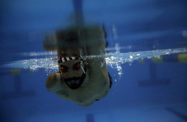 Brazil's Paralympic swimmer Daniel Dias trains at an indoor swimming pool in Braganca Paulista