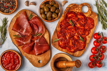 Spanish tapas with  chorizo,  jamon, picnic table.