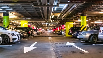 Modern, organized underground car parking garage. Perspective view. High-tech architecture
