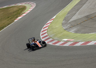 Manor Racing Formula One driver Haryanto of Indonesia takes a curve with his car during the third testing session ahead the upcoming season at the Circuit Barcelona-Catalunya in Montmelo