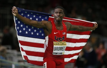 Bromell of the U.S. celebrates with an American flag after winning the gold medal in the men's 60 meters at the IAAF World Indoor Athletics Championships in Portland
