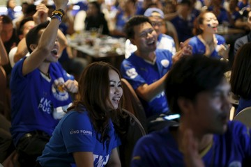 Leicester City fans watch the match against Crystal Palace, in Bangkok