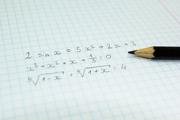 Mathematical formulas in a notebook for lectures.