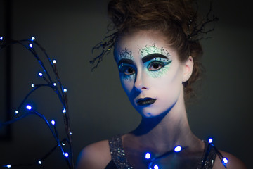 Avant Garde model with creative makeup and light