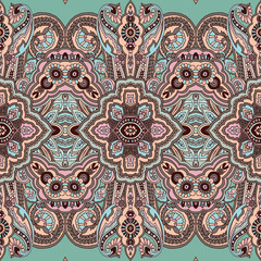 Seamless abstract geometric paisley pattern. Traditional oriental ethnic ornament, batik colors on turquoise background. Textile design.