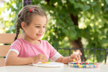 Little Girl Playing With Toys Outdoors