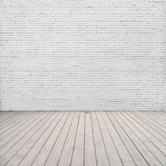 White brick wall and wood floor.