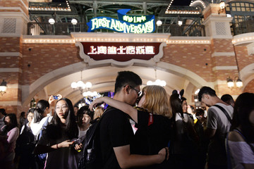 Visitors gather during a celebration ceremony to mark Shanghai Disney Resort's first anniversary in Shanghai