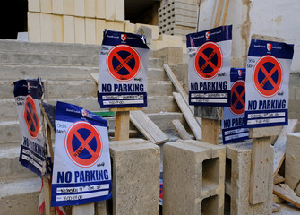 'No Parking' signs are seen by the side of the road on a construction site in Sliema