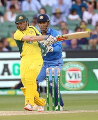 Australia's George Bailey bats as India's Mahendra Singh Dhoni watches during their One Day cricket match at the Melbourne Cricket Ground