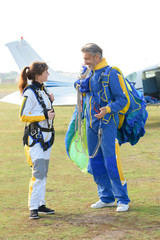 sky diving tandem getting ready to jump from the plane