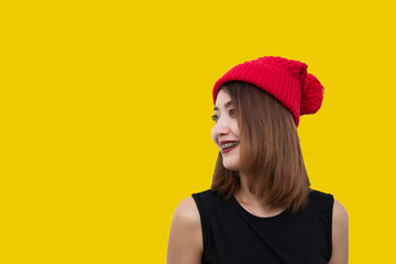 Hipsters girl wear red hat on yellow background