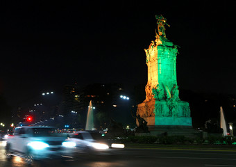 The Monumento a Los Espanoles (Monument to Spanish) is seen lit in the colours of Brazil's flag in homage to 2016 Rio Olympics, in Buenos Aires