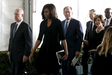 California Governor Brown, U.S. first lady Obama, former President Bush and former first lady Bush walk to the grave site at the funeral of Nancy Reagan at the Ronald Reagan Presidential Library in Simi Valley, California