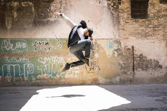 Male urban dancer in the air