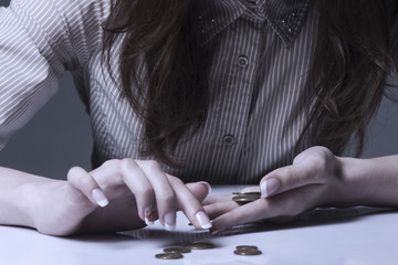 Family debts. Young frustrated and desperate Woman counting small money (Bankrupt, poverty, tax, money concept)