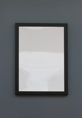 Black frame on gray wall design background for your content
