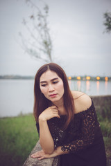 Beautiful thai woman very sad from unrequited love,rethink,think over,vintage style,dark tone,broken heart,asian girl