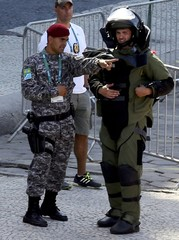 An agent of the bomb squad in protective clothing stands in the area near the finishing line of the men's cycling road race at the 2016 Rio Olympics after they made a controlled explosion, in Copacabana, Rio de Janeiro